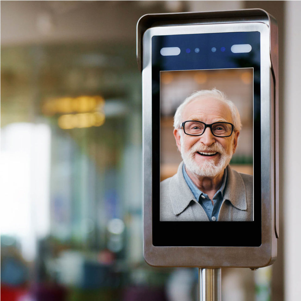 photo of senior man on an electronic device