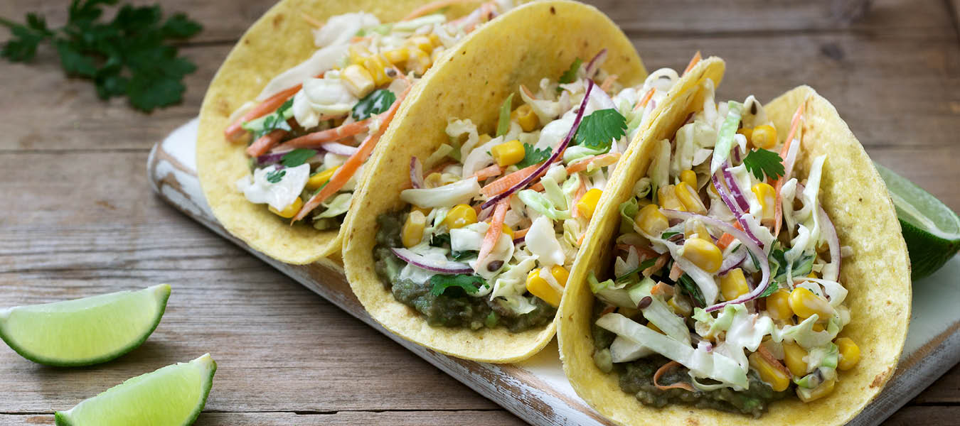 Three tacos with fresh corn and slaw