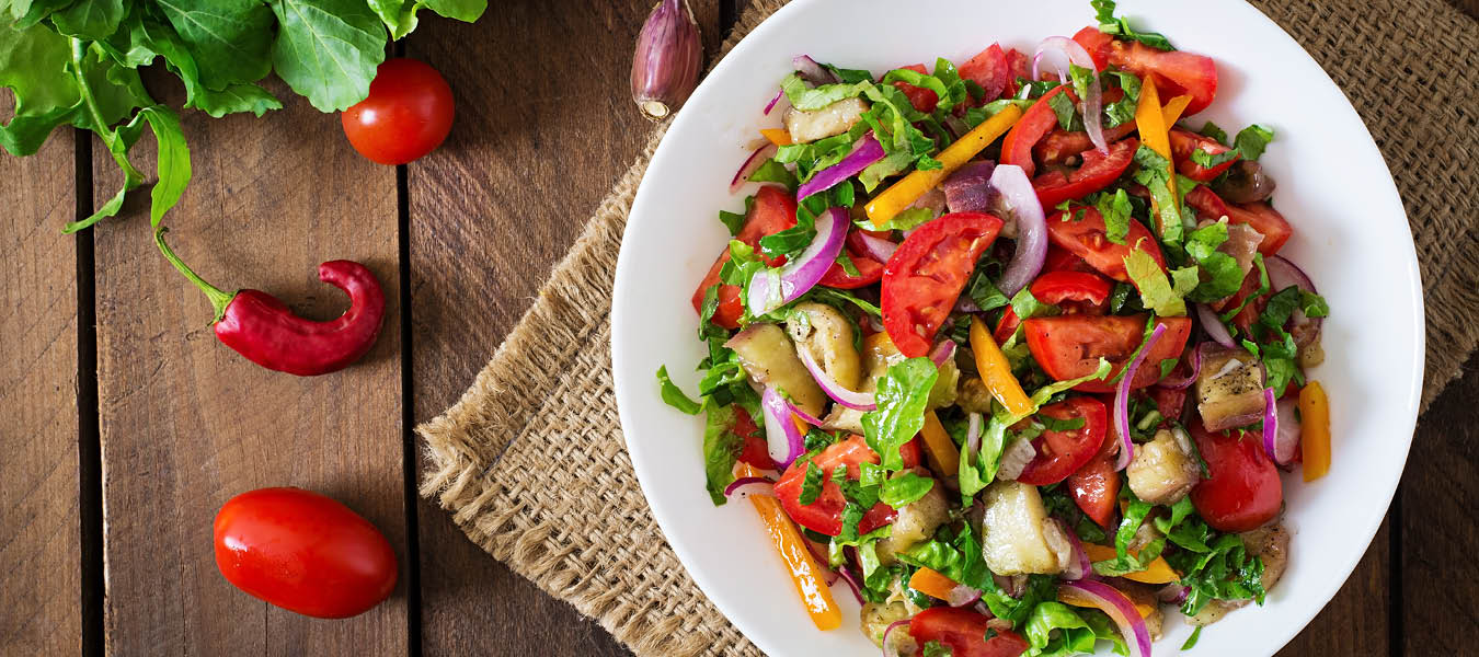 plated tomato and vegetable salad