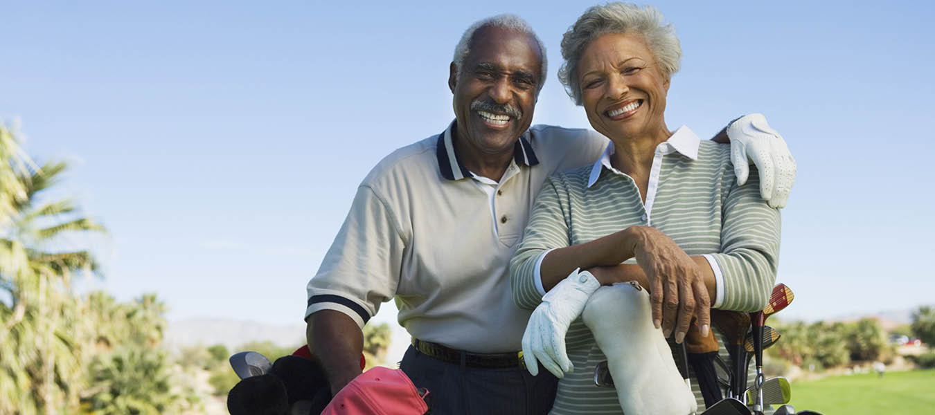 african american senior male and female couple on the golf course